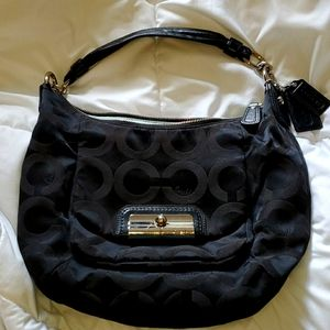 Used black Coach shoulder bag with aqua interior